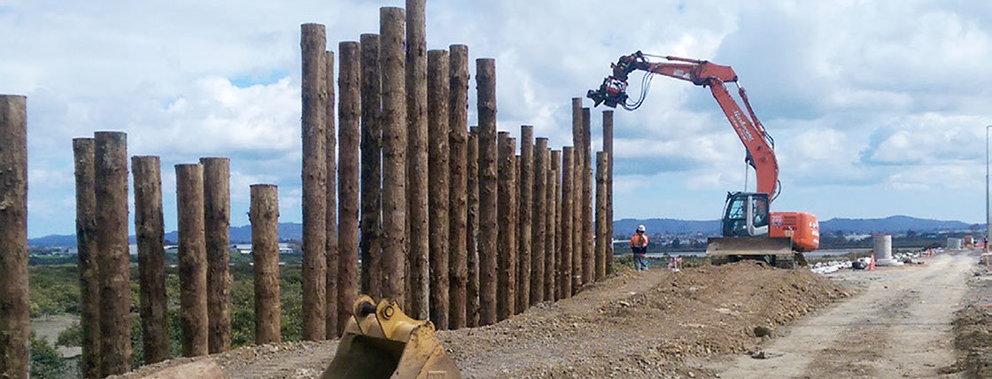 TTT MultiPole Uglie poles being installed by high frequency vibration for ground improvement of State Highway 16 Causeway Upgrade in Auckland.